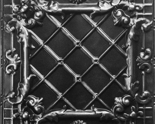 Verouderde zwarte plafondtegel met vintage look