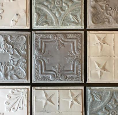 Stalen wandtegels met pasteltinten als kunst aan de muur