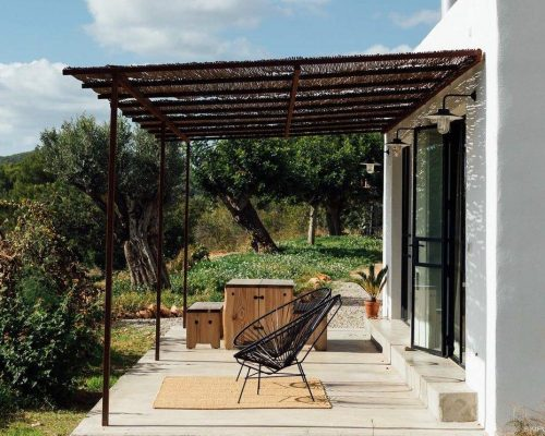 a-private-terrace-is-an-extension-of-the-interior-living-spaces-a-canopy-provides-protection-while-not-interrupting-the-surrounding-vistas