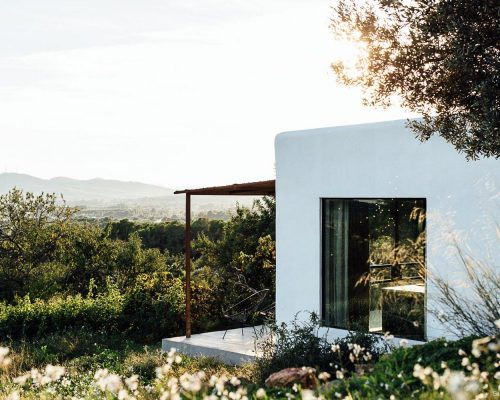 the-home-located-in-a-remote-mountain-field-in-the-rugged-north-area-of-ibiza-embraces-its-mountain-views-mediterranean-climate-and-ibizan-roots